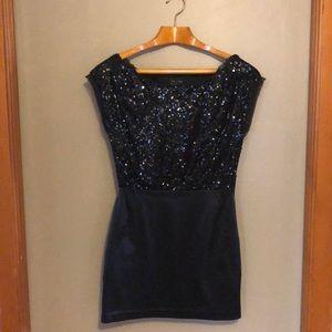 Off-shoulder black sequined minidress. Size 6